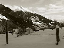 panorama of alpine peaks seen from behind the fence stock photo