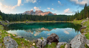 Panorama of Alps lake landscape with forrest mountain, Lago di C Stock Images