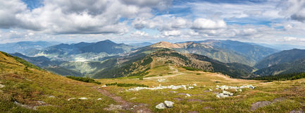 Panorama from amazing autumn mountains under blue sky with cloud Stock Images