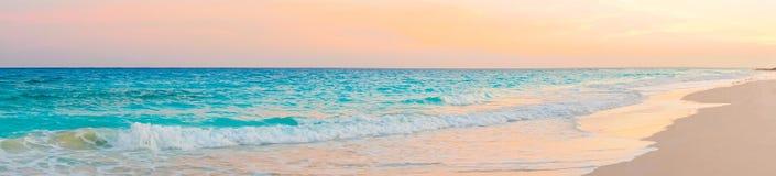 Panorama of amazing beautiful sunset on an exotic caribbean seashore. Stunning beautiful sunset on an exotic caribbean beach Stock Photography