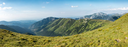 Panorama of amazing summer mountains under blue sky Stock Photography