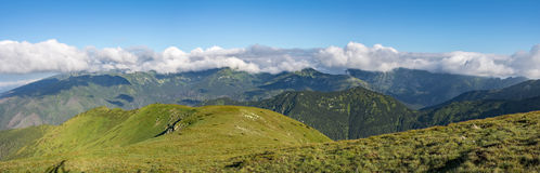 Panorama of amazing summer Slovak mountains. Panorama of amazing summer mountains under blue sky with white clouds - West Tatras, Slovakia, Europe Stock Images
