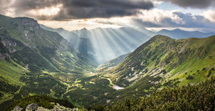 Panorama of amazing sunrise over mountain valley Stock Images
