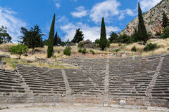 Panorama of Amphitheater in Ancient Greek archaeological site of Delphi, Greece Stock Images