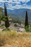 Panorama of Amphitheatre in Ancient Greek archaeological site of Delphi, Greece Royalty Free Stock Image