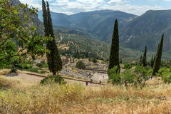 Panorama of Amphitheatre in Ancient Greek archaeological site of Delphi, Greece Royalty Free Stock Images