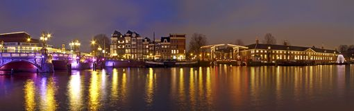 Panorama from Amsterdam in the Netherl. Panorama from Amsterdam innercity with the Amstel in the Netherlands by night Stock Images