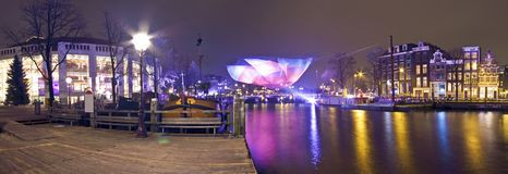 Panorama from Amsterdam in the Netherl. Panorama from Amsterdam innercity with the Amstel in the Netherlands by night Royalty Free Stock Photography