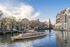 Panorama of Amsterdam with touristic boat, The Netherlands Royalty Free Stock Images