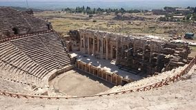 Panorama of the ancient Greco-Roman city. The old amphitheatre of Hierapolis in Pamukkale, Turkey. Destroyed ancient stock photo