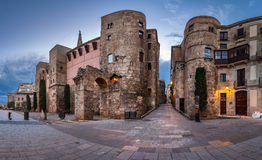 Panorama of Ancient Roman Gate and Placa Nova in the Morning Stock Photography