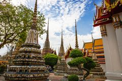 Panorama of Ancient Stupas and pagoda in Wat Pho temple royalty free stock photo