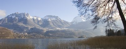 Panorama of Annecy's lake and snowed moutains. Panorama of Annecy's lake,snowed moutains, and Duingt's castel Stock Photos