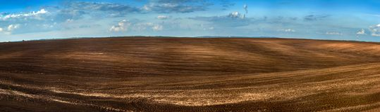 Panorama of arable land over amazing clouds sky. Panorama of arable land over amazing clouds Stock Photography