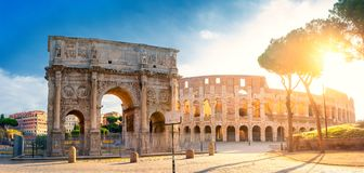 Panorama of the Arch of Constantine and the Colosseum in the morning sun. Rome architecture and landmark stock photography