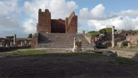 Archaeological excavations in Ostia Antica with the Capitolium  and ruins. Panorama at archaeological excavations of Ostia Antica with the Capitolium  surrounded stock footage