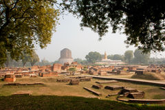 Panorama with archeological site at Sarnath ruins and Buddhist Dhamek stupa Royalty Free Stock Image