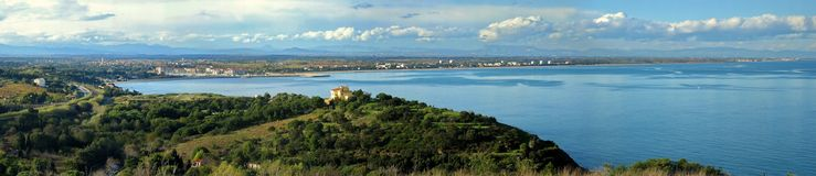 Panorama of Argeles sur Mer. Mediterranean coastline panorama with the seaside town of Argeles sur Mer in background, Roussillon plain, Pyrenees Orientales Royalty Free Stock Images
