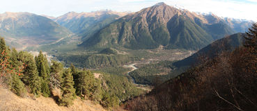 Panorama of Arkhyz village and Caucasus mountains. Stock Images