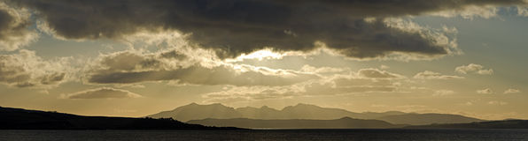 Panorama of Arran in Scotland UK. The mountains of the island of Arran in Scotland viewed from Largs in Ayrshire, Scotland. This is a high resolution panorama Stock Images