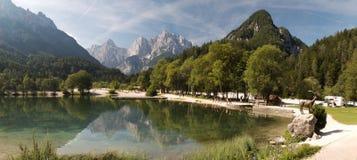 Panorama of artifiical lake with Razor and Prisojnik mountains north of Krajnska Gora Royalty Free Stock Photos