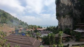 Panorama of an Asian village by the sea from a high hill. Right cliff.  stock footage