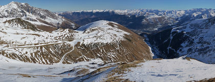 Panorama of Aure Valley in Hautes Pyrenees surrounded by mountai. Panorama of Aure Valley in Hautes Pyrenees in winter, seen from slopes of Saint-Lary-Soulan ski Royalty Free Stock Photos