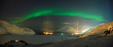 Panorama of Aurora polaris. Above mountains royalty free stock photography
