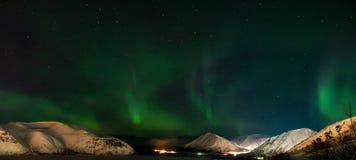 Panorama of Aurora polaris. Ribbons of Aurora polaris above a mountain valley stock image