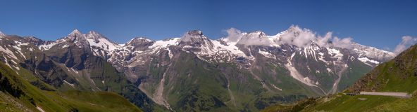 Panorama of the Austria Alps from the Grossglockner high Alpine Road. With glaciers, mountains, waterfalls and meadows stock images