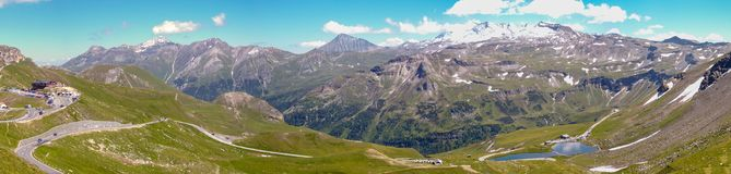 Panorama of the Austria Alps from the Grossglockner high Alpine Road. With glaciers, mountains, waterfalls and meadows royalty free stock photo
