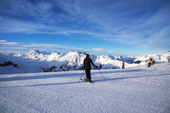Panorama of the Austrian ski resort Ischgl with skiers. Royalty Free Stock Photo