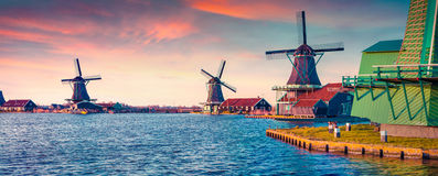 Panorama of authentic Zaandam mills on the water channel Royalty Free Stock Photo