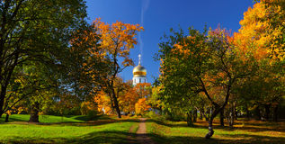 Panorama of an autumn landscape with church. Stitched Panorama of an autumn landscape with orthodox church Royalty Free Stock Photo