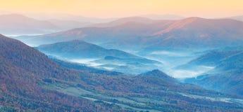 Panorama of the autumn mountains. Stock Photos
