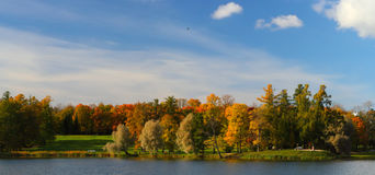 Panorama of the autumn park. With the lake Stock Photos