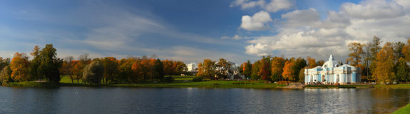 Panorama of the autumn park. Stitched Panorama of the autumn park with the lake Royalty Free Stock Images