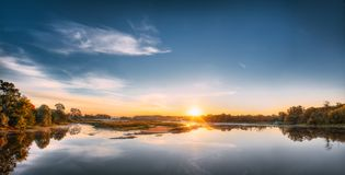 Panorama Of Autumn River Landscape In Europe At Sunrise. Sun Shine. Over Blue Water Lake Or River At Sunset. Nature At Sunny Morning. Woods On Riverside Coast Royalty Free Stock Image
