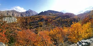 Panorama of Autumn scenery in valley and mountains in sunny day stock photos