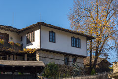 Panorama with autumn tree and old house in village of Bozhentsi, Bulgaria Stock Photos