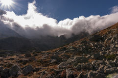 Panorama of autumnal mountains under the clouds Royalty Free Stock Photos