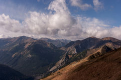Panorama of autumnal mountains under the clouds.  Royalty Free Stock Photography