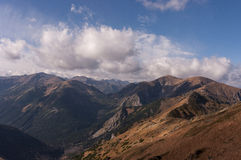 Panorama of autumnal mountains under the clouds.  Royalty Free Stock Photo