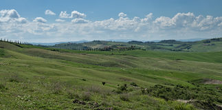 Panorama av det Tuscan landskapet på den Val d'Orciaen, Italien Arkivbild