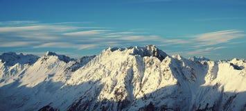 Panorama av fjällängarna övervintrar morgonen, Ischgl, Österrike Fotografering för Bildbyråer