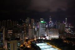 Panorama av Hong Kong på natten Arkivbild