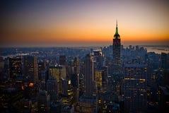 Panorama av manhattan på solnedgången, New York Arkivbild