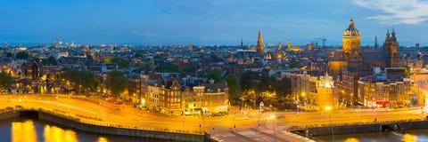 Panorama av natten Amsterdam Fotografering för Bildbyråer