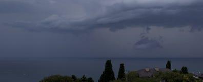 Panorama av regnmoln över havet Royaltyfria Bilder