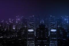Panorama av staden på midnatt Arkivfoto